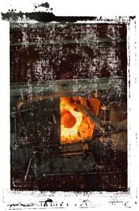 adding wood to boiler 0001