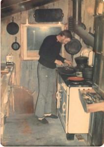 denny at stove